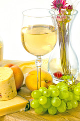 fresh green grapes and a glass of white wine