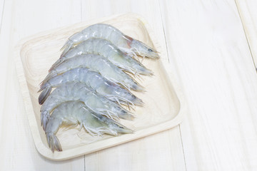 Fresh shrimp prepare for cook on wooden dish and wooden backgrou