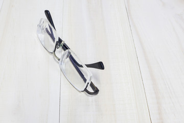 Thick lens glasses on wooden background