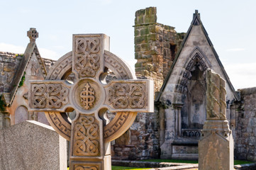 celtic cross on a graveyard in st. andrews, scotland