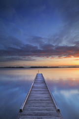 Jetty on a lake at sunrise, near Amsterdam The Netherlands