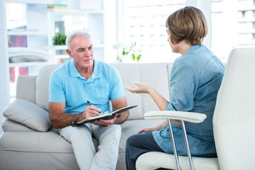 Doctor discussing with patient at home