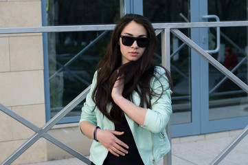 Street fashion concept - stylish cool girl in black & blue style
