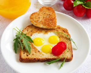 Toast with quail eggs in the form of heart.