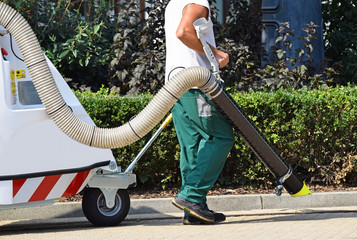 Street cleaner works with a large vacuum cleaner