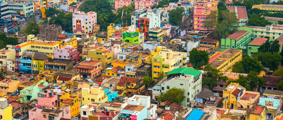 cityscape of colorful homes in crowded Indian city Trichy, panor