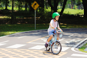 Boy practice biking on the road
