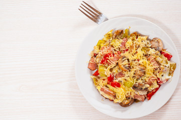 fried eggs with pepper, mushrooms, ham and cheese