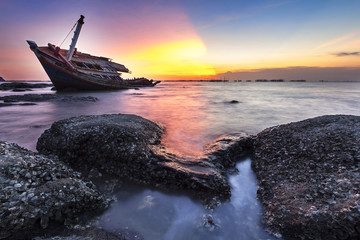 Garden Poster Shipwreck beautiful sunset on the beach.