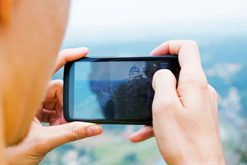 Man's hands making picture with a smart phone