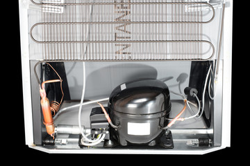 Domestic refrigerator compressor mounted on the rear side