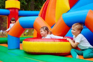 excited kids having fun on inflatable attraction playground