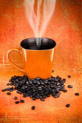 Orange coffee mugs and coffee beans