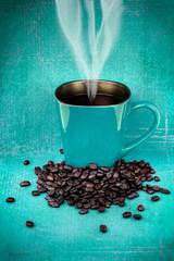 Green coffee mugs and coffee beans