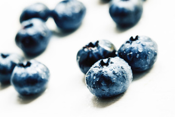 Fresh ripe blueberries on white background, selective focus