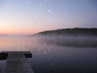 abstract photo of misty and foggy lake at sunset.