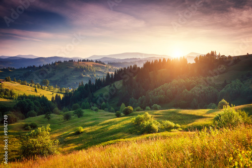 Wall mural Summer sunset in mountains