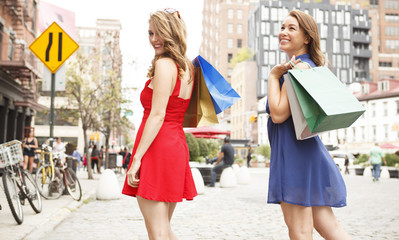 Two women having fun out shopping.