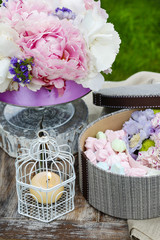 Garden party table: box of sweets and bouquet of flowers