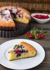 Sponge cake with berries - cranberries and blueberries
