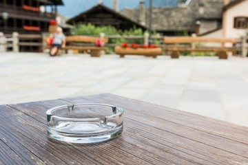 Empty glass ashtray on a wooden table