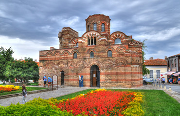 NESSEBAR, BULGARIA - SEP 8: HDR image of people visiting the Pantokrator church in the old town of Nessebar. The site forms part of the Ancient City of Nesebar UNESCO World Heritage Site. Sep 8, 2015