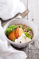 Quinoa bowl with peach and mozarella