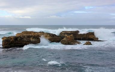Waves crashing on rocks at coastline in Australia