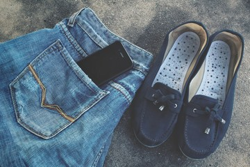 Sneakers and jeans with smart phone