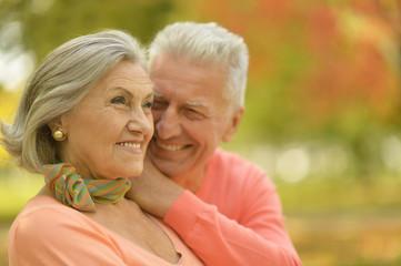 Elderly couple smilling together