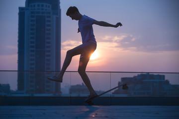 Stylish teenager makes a longboard tricks
