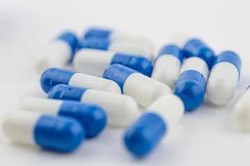 Blue and white capsules