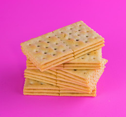 Biscuits on pink background