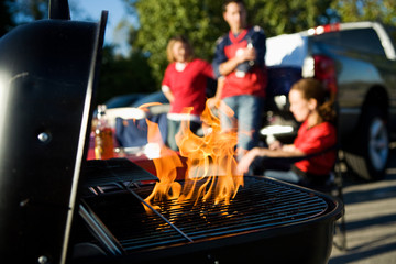 Tailgating: Flames Rise As Charcoal Is Prepped For Cooking