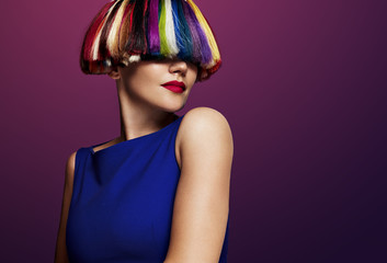 woman with a creatie color of hair. rainbow hair