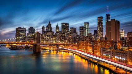 Fototapete - Brooklyn Bridge and the Lower Manhattan at dusk