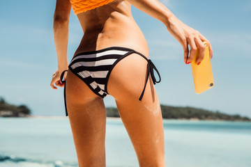 Sporty beautiful young woman in sexy bikini on a tropical beach