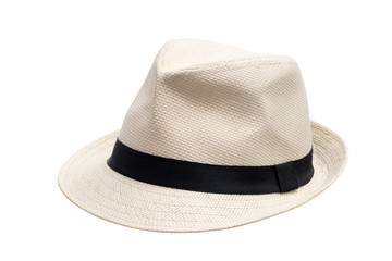 Panama straw hat with black ribbon seen from front left on white background