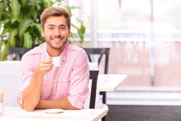 Handsome man sitting at the table