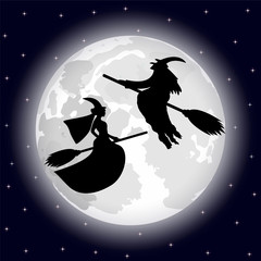 two witches on a background of the full moon on Halloween night