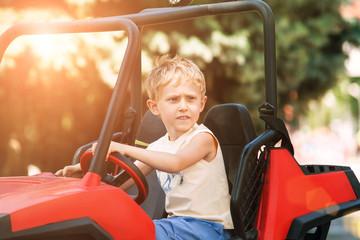 Boy drive electric mini park in park