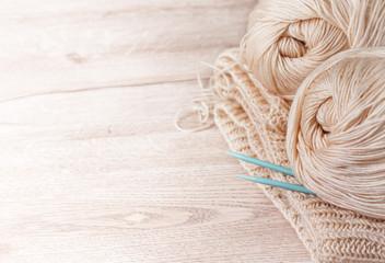 balls of yarn and knitting needles