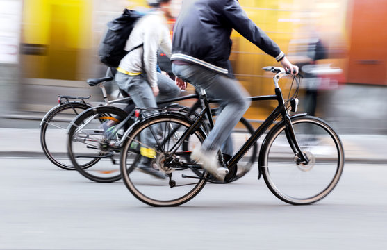 Three men on bikes