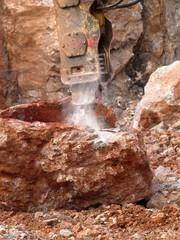 Hydraulic breaker break the stone