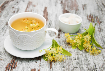 Wall Mural - cup of herbal tea with linden flowers