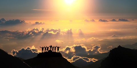 On the top of the world together. A group of people stands on a hill over the beautiful cloudscape. Wall mural