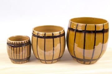 Three barrel-shaped cup