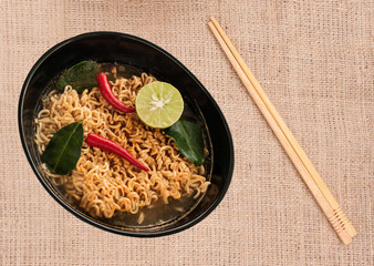 Hot spicy noodle (tom yam) with thai herb