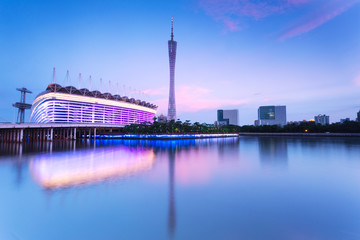 landmark of the city in China at dusk near the water
