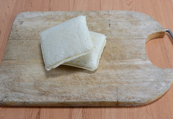 sandwich on wooden chop plate